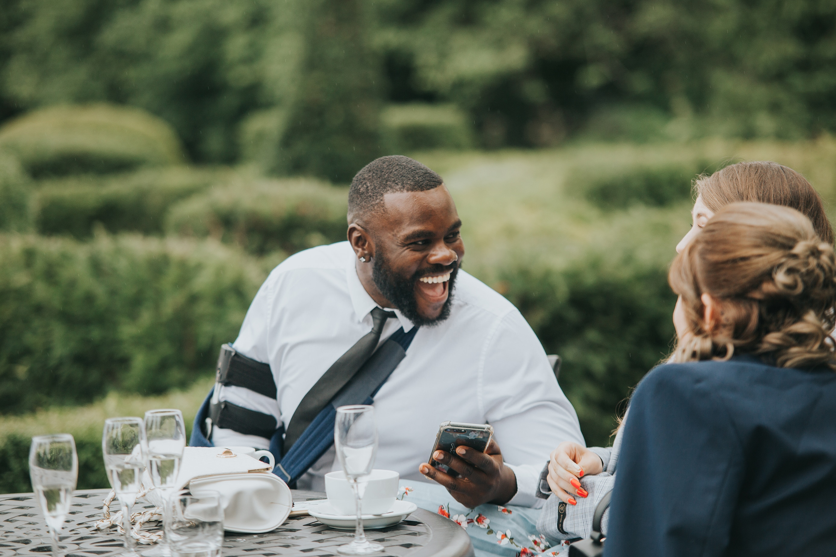Wedding Guest Laughing at Lemore Manor in Hereford